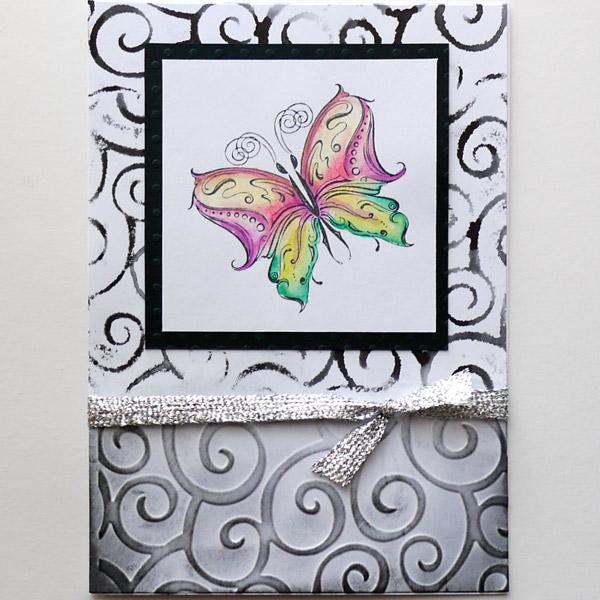 Bunter Schmetterling auf Schwarz-Weiss