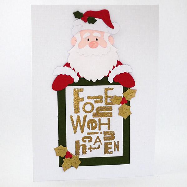 Weihnachtsmann mit Weihnachts-Schild