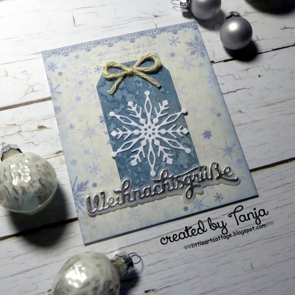 Weihnachtsgrüße und eine Schneeflocke